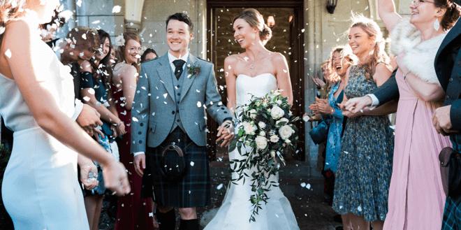 Just married couple outside of Mercure Aberdeen Ardoe House Hotel